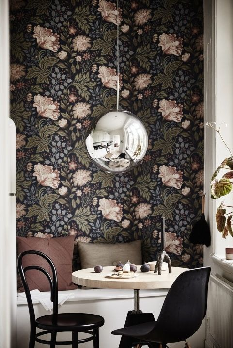 Saeting nook and fab wallpaper in the dining area of a serene small space apartment in Sweden. Ahre.:
