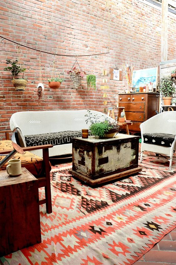 Simple textured loft space from the home of Brooke Eide. The center chest table sets the tone.