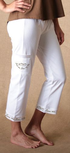 """Classic capri cut jammie pants feature a roll-over waistband, satin trimmed cuffs with playful messaging and a side (cell phone) pocket embellished with a matching embroidered message.  On this pair? Love me, Love my dog! It's an edict that runs through every dog lover's mind, so we figured we'd bark it out loud for them with our new """"Love Me, Love My Dog"""" jammie pants. What's more? Look closely at the XOXO to see the O's are actually sweet and loveable paw prints."""