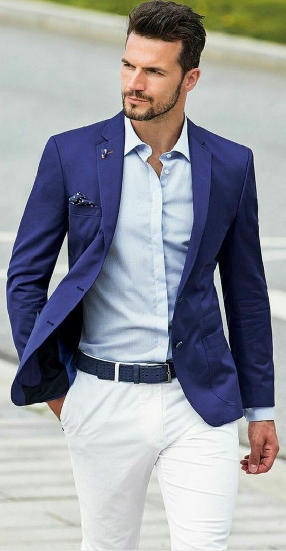 pocket handkerchief in blue, with white polka dots, worn by man in dark blue blazer, what is cocktail attire for men, pale blue shirt, white trousers with dark blue belt