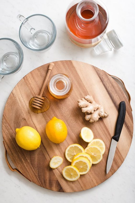 Flu Season Ginger Honey Lemon Tonic Drink. Looking for ideas and remedies for food when you're feeling sick, have a cold, or have a sore throat? This is delicious and great tasting for kids, but even better for adults as cocktails if you add bourbon or whiskey. Like homemade cough syrup or medicine that will have you feeling better in no time.
