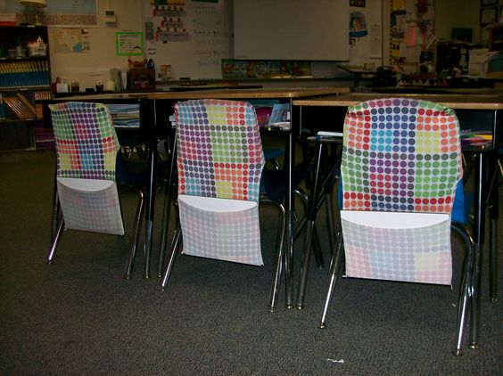 Large stretchable book covers han on the back of student chairs and hold individual whiteboards, black socks for erasers and dry erase markers! Wow.    From: The Frugal Teacher: My Classroom: