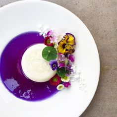Lemongrass Panna Cotta In Butterfly Pea Gel Fond, Snow, Isomalt Droplets and Edible Florals