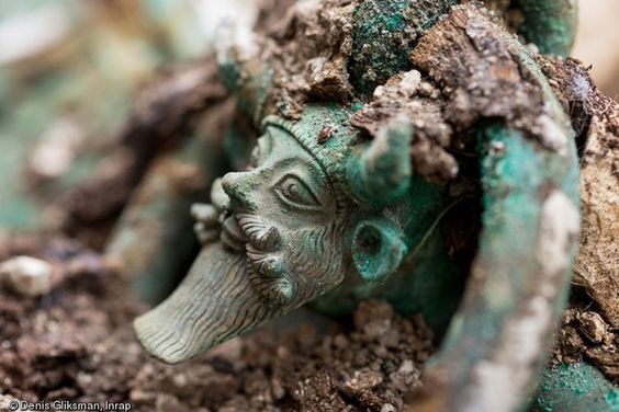 Handle of a bronze cauldron representating the Greek God Achelous from an Iron Age Hallstatt elite tomb discovered in France