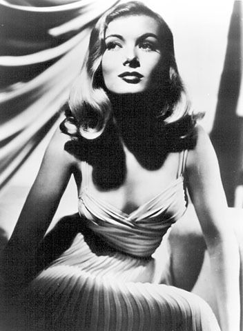 """veronica lake.  This little star was paired with Alan Ladd in movies because she was just 4' 11"""" and she made Alan Ladd look  tall at 5' 5"""" ... She  always had her right eye covered with a big wave of hair....It was called the Veronica Lake Look.....:"""