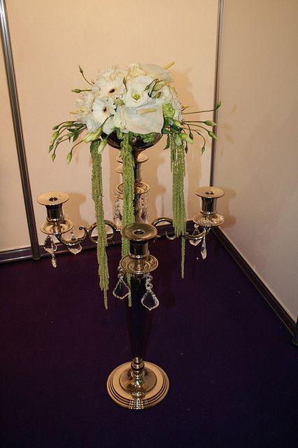 Floral Candelabra for Wedding Table Centre Piece     . Superb idea. More items here:  http://adriankmarketing.com/products/?cat=13