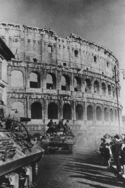 Allied tanks roll by the Coliseum during the Liberation of Rome, 1944. (Getty)