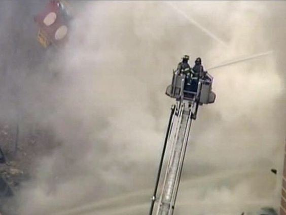 FIREFIGHTERS PUTTING OUT FIRE IN COLLAPSE BUILDING TODAY MARCH 12, 2014 EAST HARLEM IN NEW YORK CITY