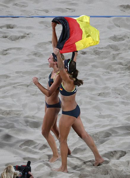 Laura Ludwig and Kira Walkenhorst of Germany celebrate winning gold during the Beach Volleyball Women's Gold medal match against Agatha Bednarczuk Rippel of Brazil and Barbara Seixas de Freitas of Brazil on day 12 of the Rio 2016 Olympic Games at the Beach Volleyball Arena on August 17, 2016 in Rio de Janeiro, Brazil.