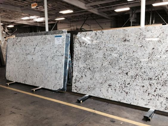 granite countertops with light wood cabinets