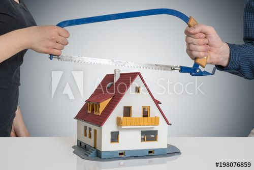 Divorce And Dividing A House Concept Man And Woman Are Splitting Model Of House With Saw Comprar Esta Foto E Explorar Home And Family Divorce Home Mortgage