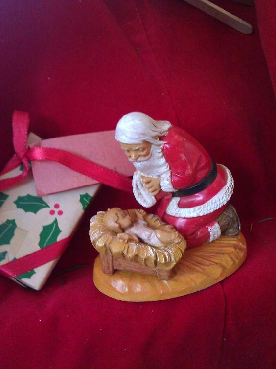 Santa worshipping the Christ Child