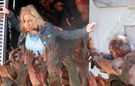 "DAWN OF THE DEAD (2004)  Sheriff: ""Danny, put another round in that woman over there! Look! She's a twitcher!""      An injection of mordant wit and a transfusion of black humour ensured that Zack Snyder's remake of the George A Romero horror classic isn't braindead. A cross-section of American society hides inside a Milwaukee shopping mall while zombies threateningly maraud outside."