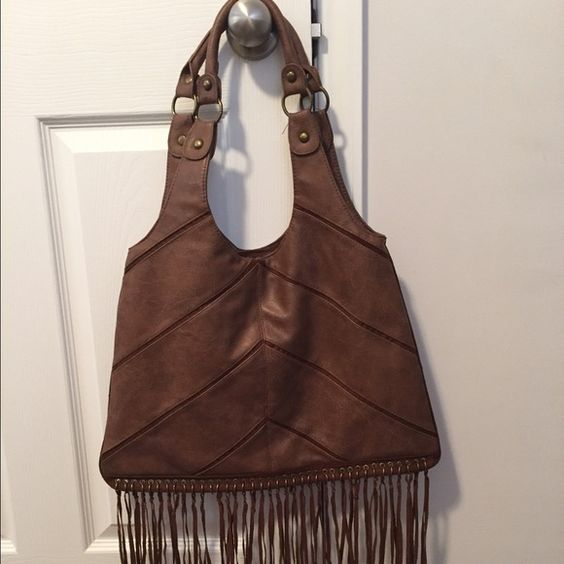 "Bohemian Rhapsody bag Nothing screams boho more than this funky bag! The fringe gives this bag that little something extra that screams ""I am a good time!"" Great summer bag if you plan on going to a concert! Bags Hobos"