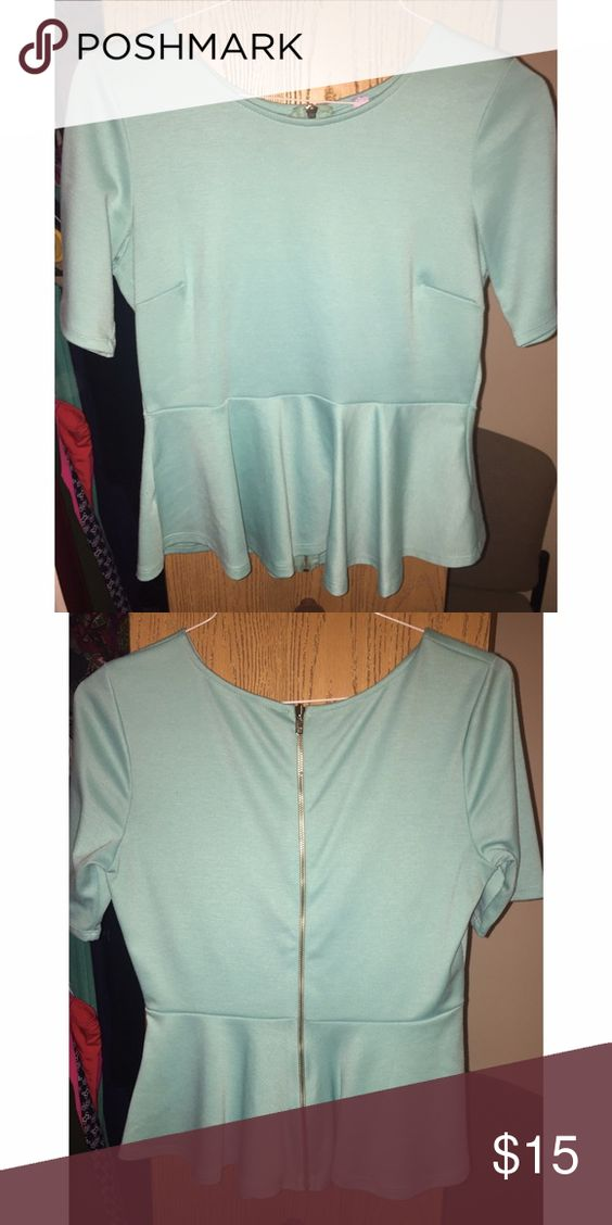 Francesca's Alya Peplum Shirt Adorable peplum shirt from Francesca's! Turquoise with exposed back zipper Francesca's Collections Tops Blouses