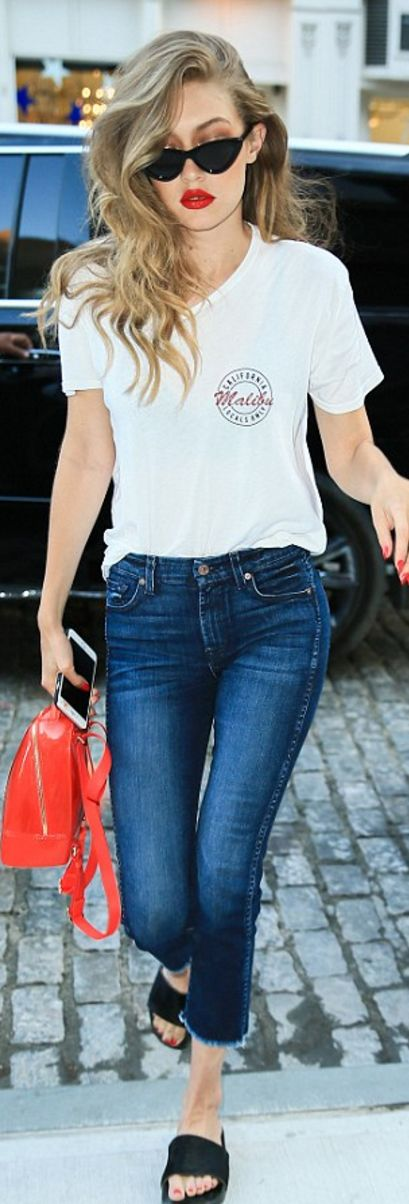 Gigi Hadid: Sunglasses – Le Specs  Purse – Furla  Shirt – Brandy Melville  Jeans – 7 For All Mankind: