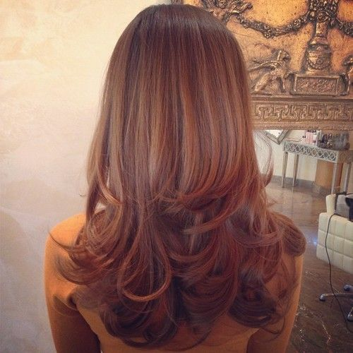 Golden brown haircolor with long layers.