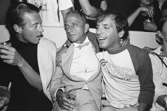 Halston, Roy Cohn, and Steve Rubell at a Victor Hugo performance at The Mudd Club, 1979.