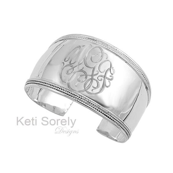 Designs by Keti Sorely.  This hand engraved cuff bangle will spell out your monogrammed initials in pretty script font.  Metal: Sterling Silver