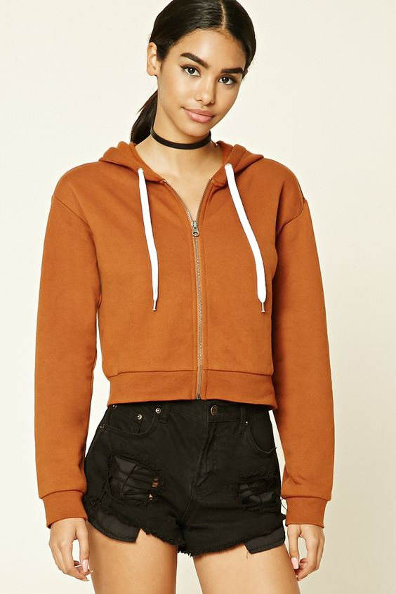 A knit zip-up hoodie featuring contrast drawstrings, fleece lining, and long sleeves.