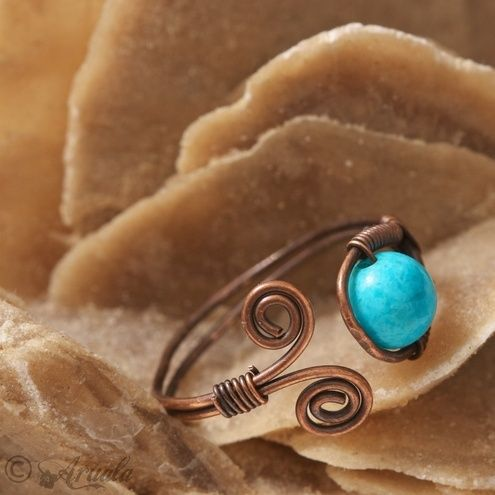 Easy wire ring with a turquoise bead.   I say bracelet:
