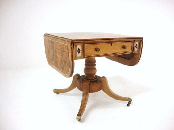 John Stevens Pembroke Table. Outstanding George IV drop-leaf table w/pedestal base, burled walnut veneered panels & fine inlay work, brass casters, delicate string work, the drawer has a lock & key, very fine. Dated 1979 from a fine English artisan