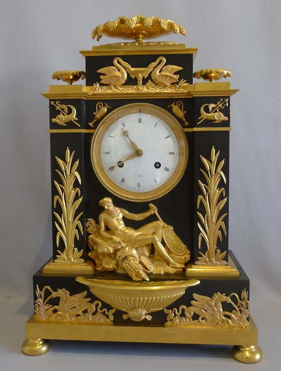 Antique French Empire clock in ormolu and patinated bronze celebrating Poseidon. - Gavin Douglas Antiques