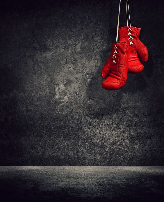 Red laced boxing gloves hanging: