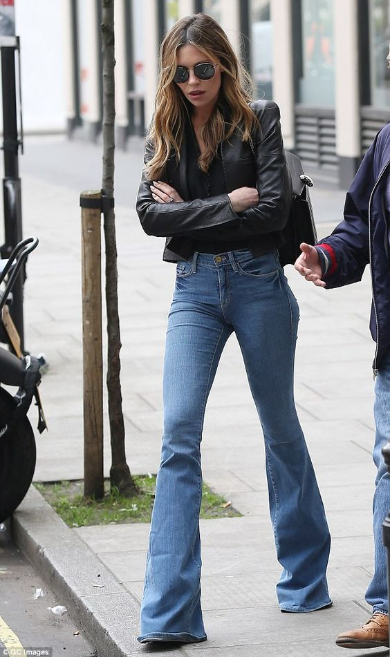 Throwback Thursday! Britain's Next Top Model head judge Abbey Clancy, 31, gave another affirmative nod to the past on Thursday morning by stepping out in London wearing a pair of seventies inspired flares