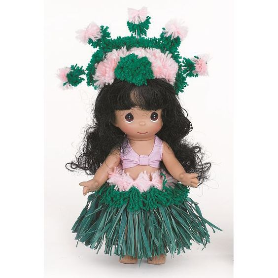 This Precious Moments doll is dressed as a Hula dancer from her native Hawaii. Description from flossiesgifts.com. I searched for this on bing.com/images