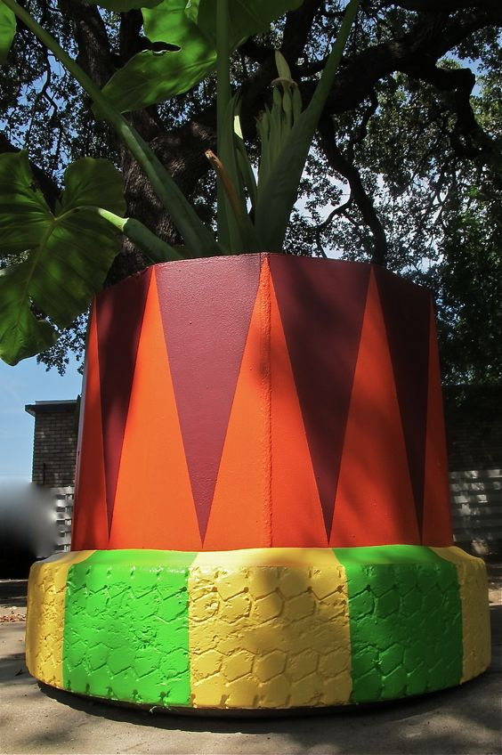 Painted planter of pipe and tires @ Fresa's Chicken Al Carbon Austin Texas in// Red Start Design Studio collaboration with Margaret Vera