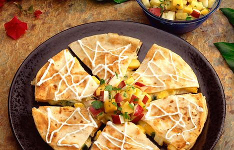 Quesadillas with tomato, green onion, cheese, garlic, lime and chillies