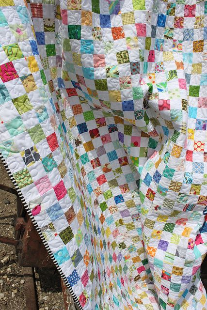 THIS one inspires me to try a postage stamp quilt.:
