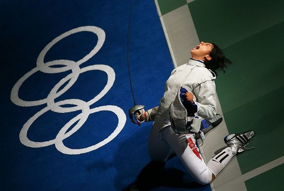 Azza Besbes of Tunisia celebrates winning in the Saber Round of 16 in the fencing event held at the Fencing Hall of National Convention Center during day 1 of the Beijing 2008 Olympic Games on August 9, 2008 in Beijing, China. (Photo by Clive Brunskill/Getty Images)