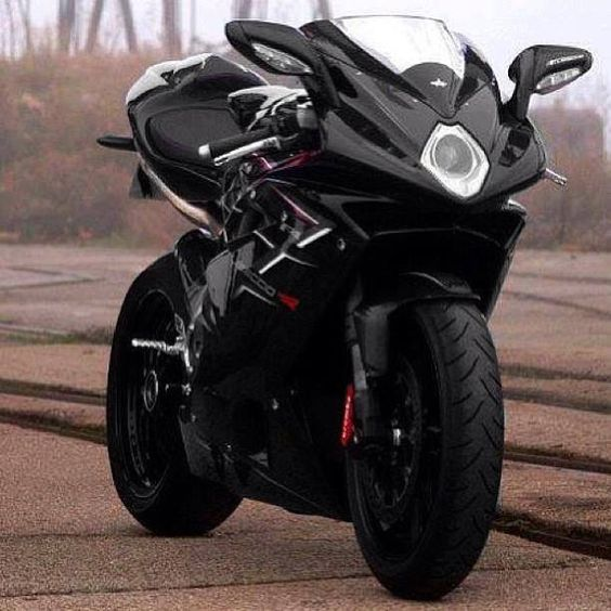 MV Agusta F4 - Another Tamburini design. Beautiful motorcycle sculpture, but what a pain to ride!