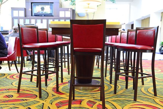 www.stainlesssteeltile.com likes the Long Island Marriott -  Skylight Lounge - Red Leather Restaurant Barstools - Modern Line Furniture