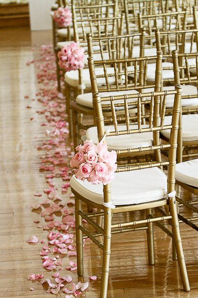 I'll have rose petals along the aisle runner and have white bows hanging from…