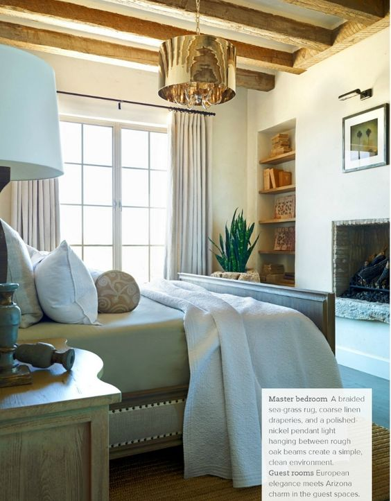 We love this bedroom with it's oak beams and luxurious copper pendant light, by Trad Home Mag.