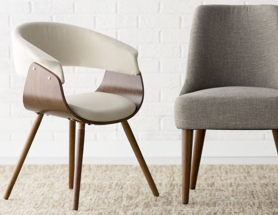 The backrest of the Vintage Mod Chair has a curve to create a perfect resting nook while the flared and tapered legs make it sturdy.