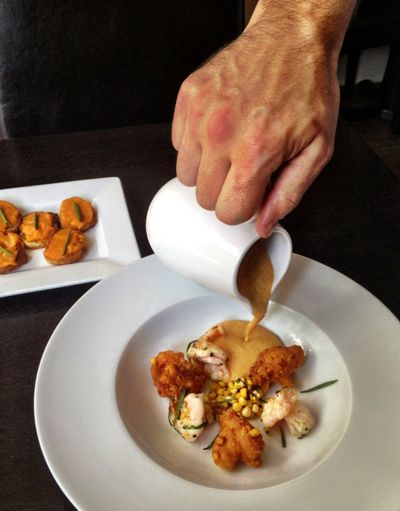 Corn bouillabaisse bisque with corn fritters & shrimp from The Boarding House