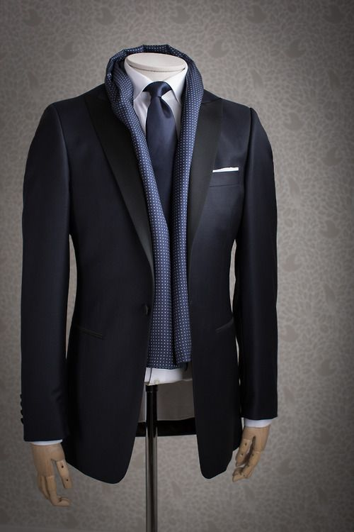 Blue textured silk scarf paired with suit, tie, and pocket square ...