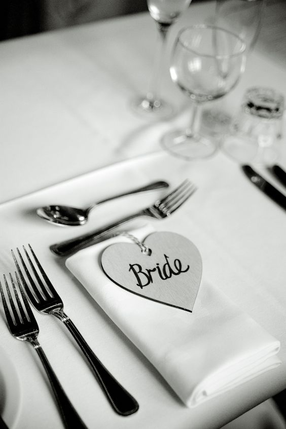 Brides table place setting with heart tag name. Photographed by Jinx Photography. www.JinxPhotography.co.uk