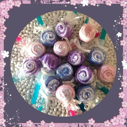 cute scrumptious lollipops! made out of weaning spoons and wash cloths, great baby shower idea