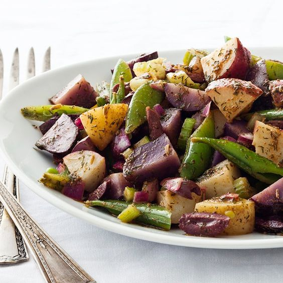 purple from the potatoes adds an appealing color to this potato salad ...