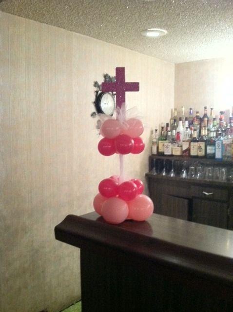Cross centerpiece communion decor and balloons