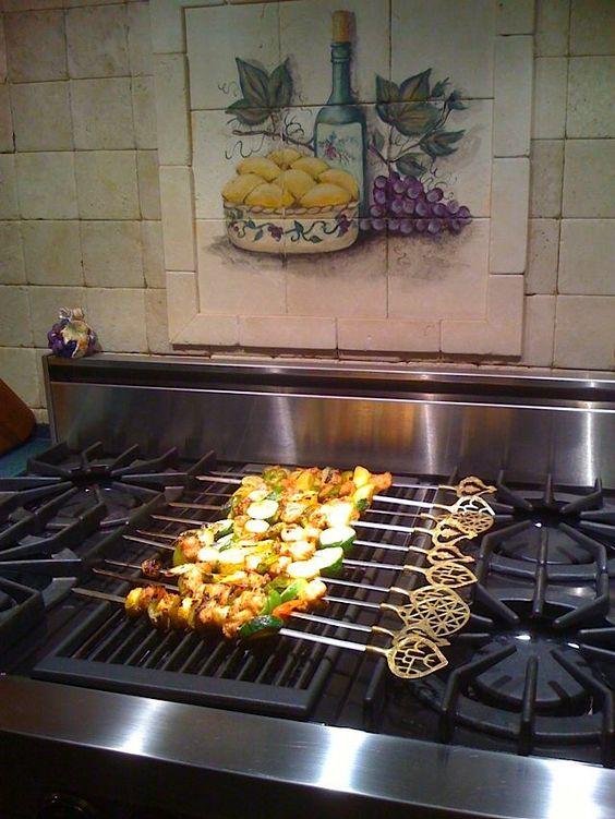 YES. Absolute must in my future kitchen: indoor grill on stove top.