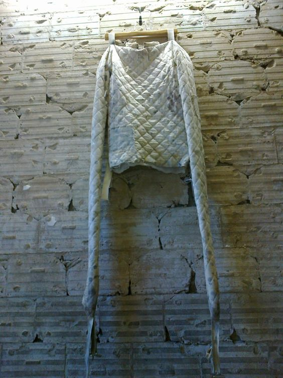 Child's Straight Jacket hangs on display. | Old Asylums ...