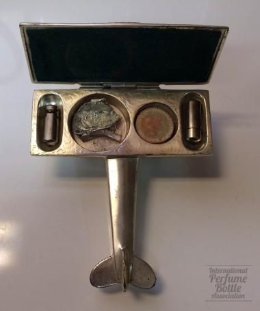 (2 of 2 photos) Airplane Beauty Box Silver tone metal  Designer/Maker:Weidlich Brothers Mfg.  Markings:Stamped on base: WB Mfg Co, 659  Origin:Connecticut, USA  Date or Era:ca. 1940's: