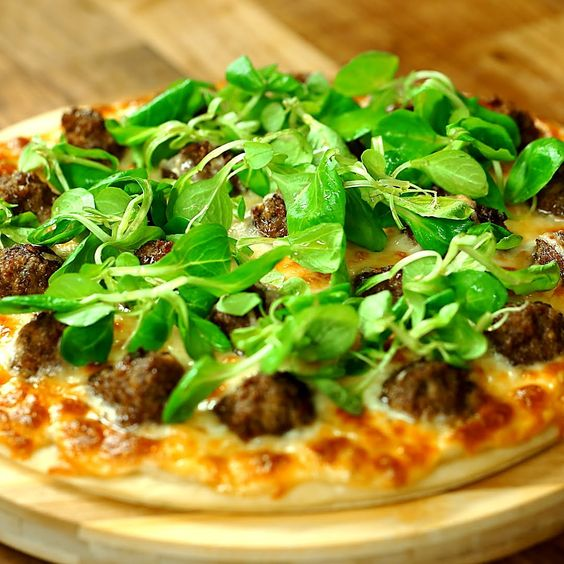 Heres our version of the classic meatball pizza. Get some good minced beef and form the meatballs. When ready place them on a round pastry sheet topped with Bechamel sauce. Let the oven do its magic and when done top the pizza with some valerian leaves and a drizzle of olive oil. Its an amazing savory pizza perfect for sharing with your loved ones!  --------------------- Follow us on:  Facebook: http://ift.tt/2bQPFq0 Instagram: http://ift.tt/2c5L3JK  Twitter: https://twitter.com/sodlco…