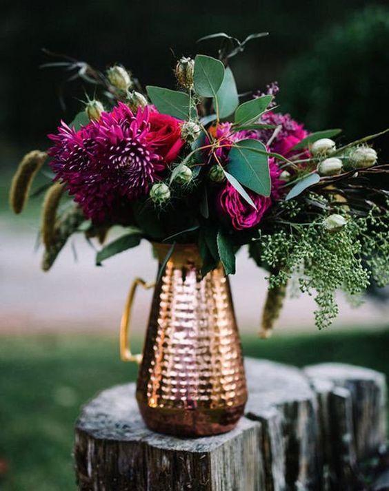jewel toned flowers in copper vase